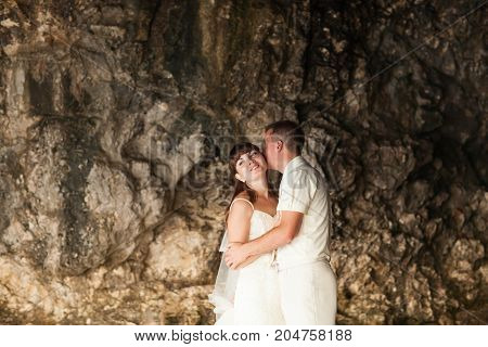 Sensual portrait of a young newlywed couple. Bride and groom outdoor.