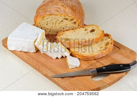 Cheese And Bread Sliced For Breakfast On A Wooden Board.