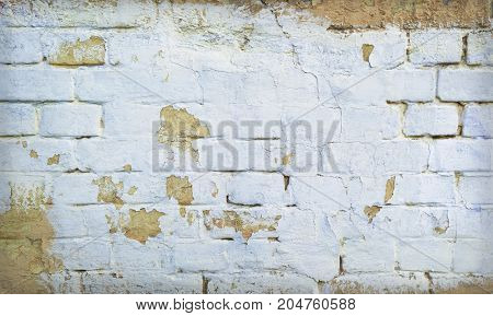 Background of old grunge brick wall texture with delicate vignetting.