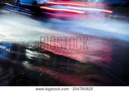 Blurred Car In Motion Splashing Rain Water Driving At Night