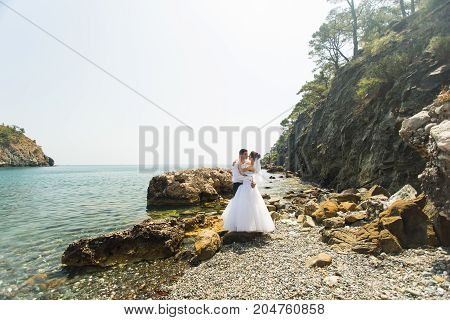 Romantic dating. Young loving couple embracing on nature.
