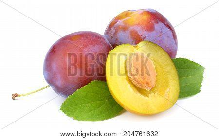 Fresh Plum Fruit With Cut Plum Slices Isolated On White Background