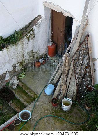Looking into neighbours untidy yard in Andalusian village