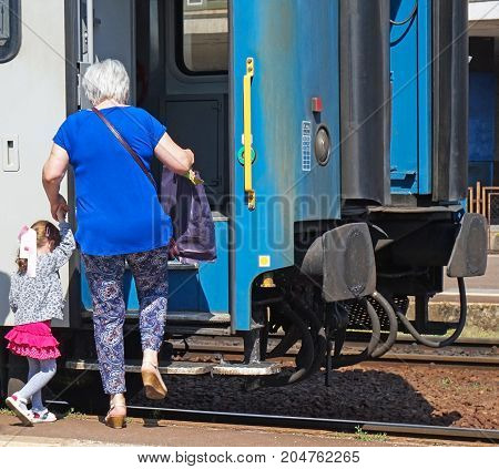 Traveling people with train in summer time