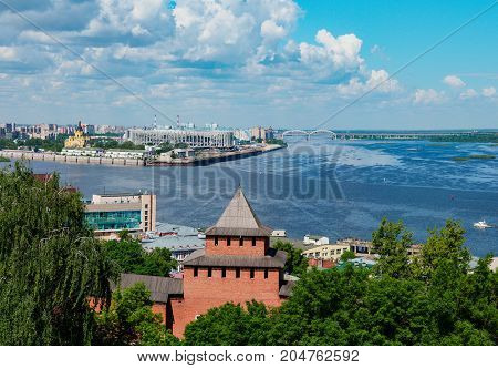 View on Kremlin tower and Strelka - place of Oka and Volga rivers junction in Nizhniy Novgorod. View from viewing point in Nizhny Novgorod Kremlin