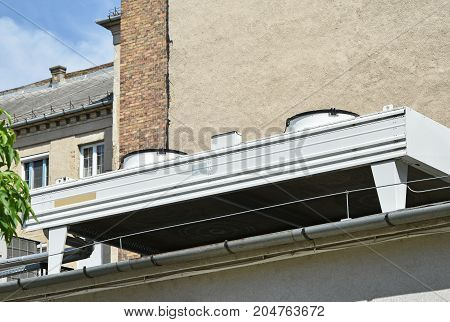 Large air conditioners on the roof of a building