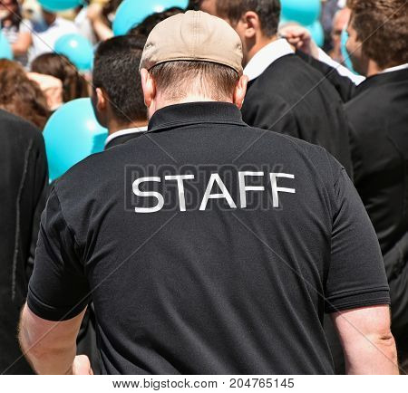 Staff member of an event on the street