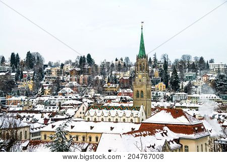 St Gallen, Switzerland. Aerial view of historical buildings covered in snow in winter. Cathedral in St Gallen, Switzerland with bright blue sky