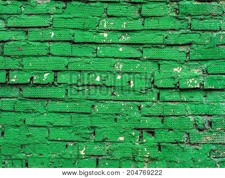 Green brick wall. Background. Grooved concrete wall background and design.