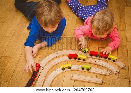learning and daycare- kids playing with trains and railroad