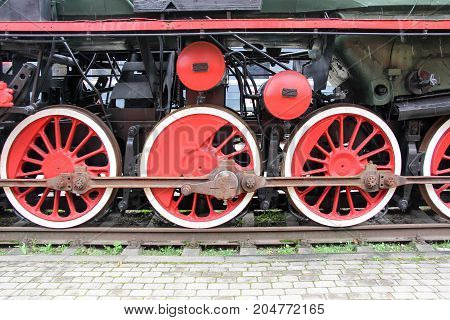 old antic train locomative aged iron wheels