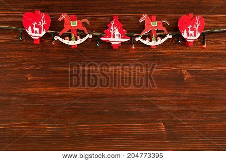 Red And White Wooden Christmas Decorations And Christmas Lights On The Brown Wooden Background, Top