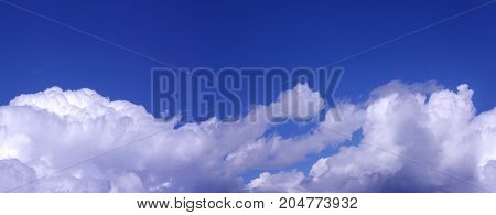 White Clouds on the blue sky as seamless pattern