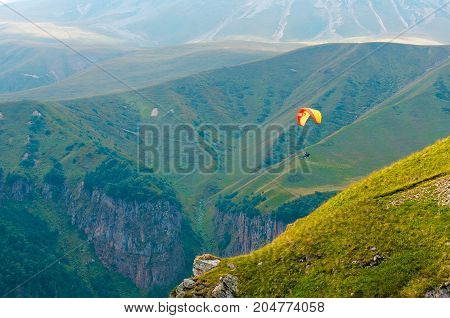 Skydiver with instructor in the sky over the Caucasus Mountains, Georgia.