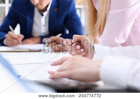 Group Of People Hold Silver Pen Ready To Make Note