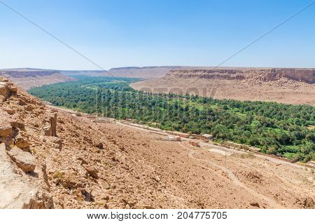 Beautiful Ziz valley landscape with palm tree oasis in Morocco, North Africa.