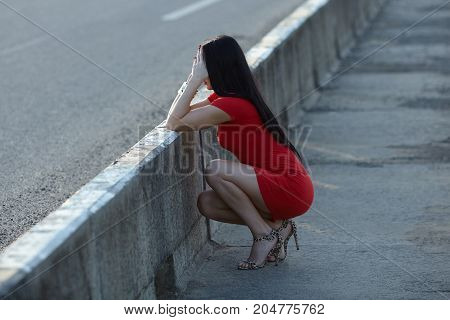 young woman crying on the bridge poverty city street negative emotion