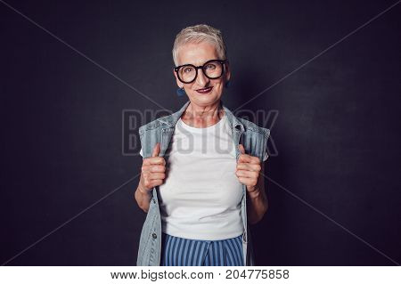 Stylish old woman in white t-shirt. Mock up.