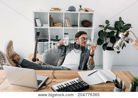 Man Drinking Coffee At Workplace