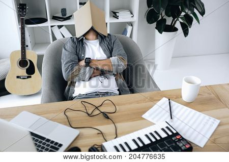 Sound Producer Sleeping With Magazine On Face