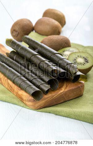 Kiwi fruit leather rolls and fresh fruits