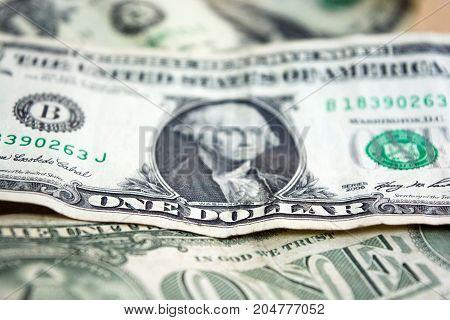 US one dollar bill closeup. Blurred one usd banknote. George Washington portrait. United states money. Business.