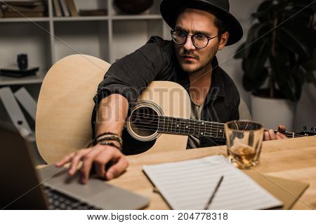 Man With Guitar And Whiskey