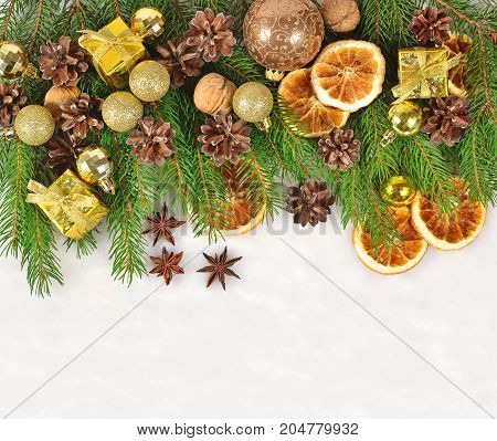 Dried Oranges And Cones, Christmas Decorations And Spruse Branch On A White