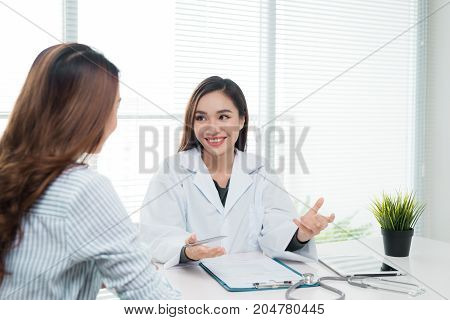 Smiling Patient In The Doctor's Office, She Is Receiving A Prescription Medicine