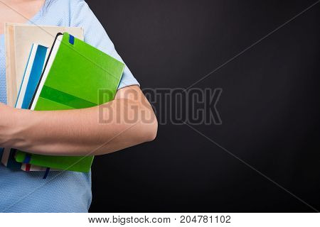 Girl Student Holding Reading Books In Closeup
