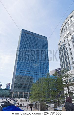 London United Kingdom - August 13 2017: The headquarters of JP Morgan at Canary Wharf in the financial heart of London pictured against a clear blue sky