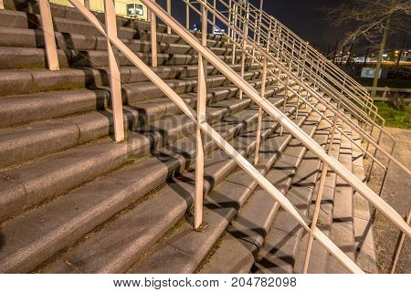 Wide stairs for thousands of spectator audiance at a football stadium