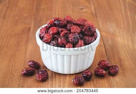 Organic dried cranberries in white ceramic bowl