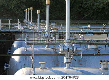 pressurized tanks for the storage of methane gas in an industrial refinery