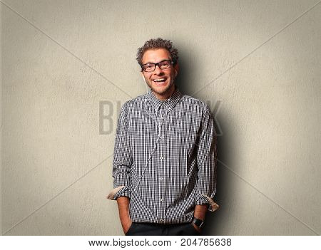 Young man in a cellular shirt is smiling