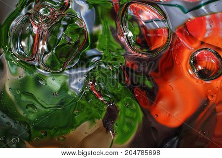 colorful background from water drops and oil