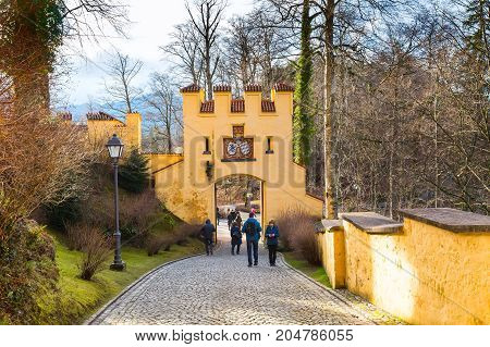 Fussen, Germany - December 27, 2016: Hohenschwangau Castle Schloss arch gate view and people