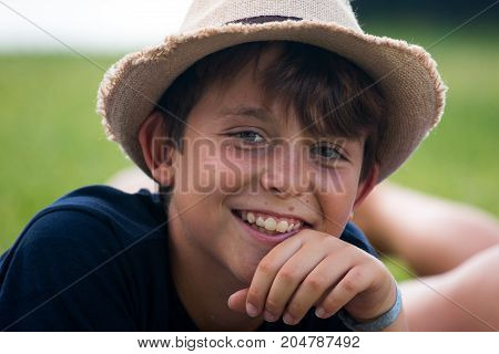 Close-up of young boy in a garden