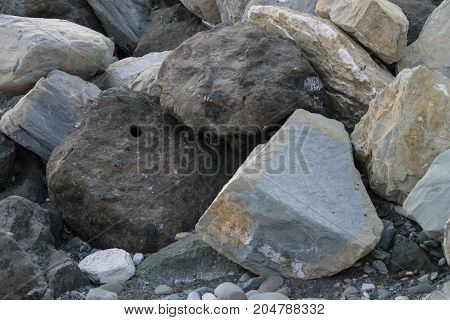 huge stones lying on the sea to protect the shore from blur in Imereti Bay