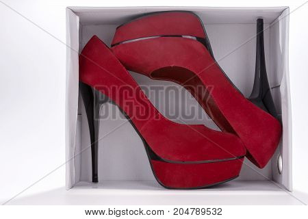Red high heel shoes in the shoe boxes