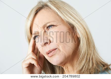 Studio Shot Of Mature Woman Suffering From Memory Loss