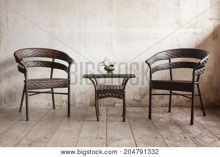 Home Decoration with chairs, table and vintage wall