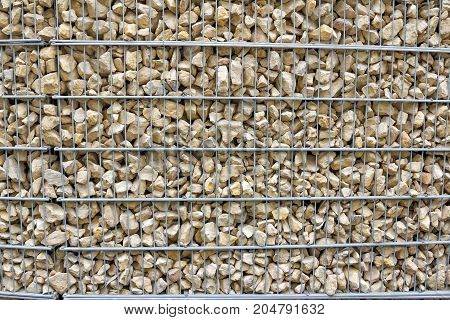 Gabion  close up - protective construction made of stones and metal wire, abstract background