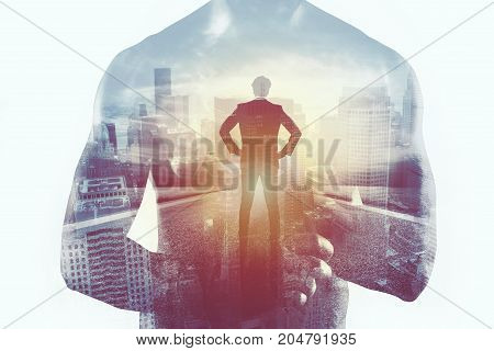 Power and determination of a fighter businessman. Double exposure photo