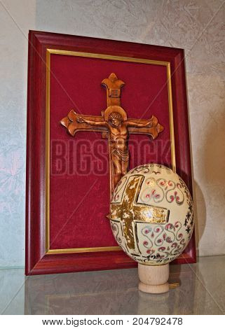 Engraving wooden cross, and decorated easter egg