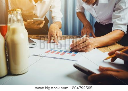 Business man working teamwork in milk bottle quality control hard job concept quantity checking in the office Facility layout planning in the future.