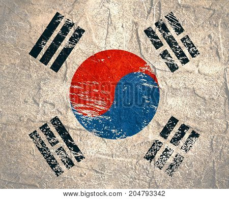 A scratched flag of South Korea with grunge texture.