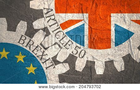 Image relative to politic situation between great britain and european union. Politic process named as brexit. Mechanism of Gears. Article 50 text. Grunge distress texture.