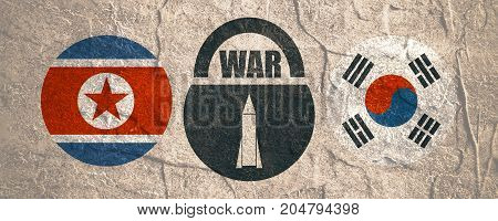 Image relative to politic situation between South Korea and North Korea. National flags on clouds divided by lock with war text and missile icon as keyhole. Grunge distress texture.
