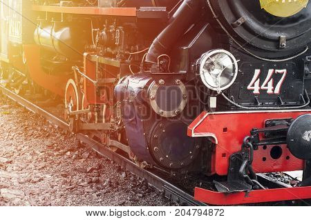 Steam engine train close up. Lamp and wheels of old fashioned  train details